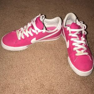 Bright pink Nike's